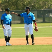 Jonathan Villar, right, works with Isan Diaz on the first day of spring training. Villar, an infielder, could end up in center field. (Craig Davis for Five Reasons Sports)