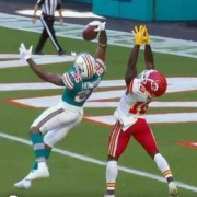 The Dolphins' Xavien Howard makes a one-handed grab for his ninth interception of the season.